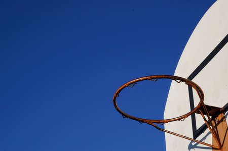 Red Basketball hoop under the sky Stock Photo