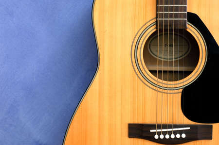 An acoustic guitat in blue background Stock Photo