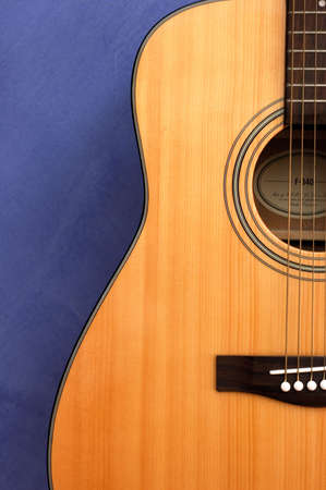 An acoustic guitar in blue background Stock Photo