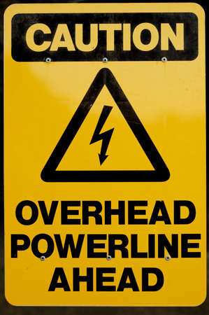 signpost of Overhead Powerline Ahead