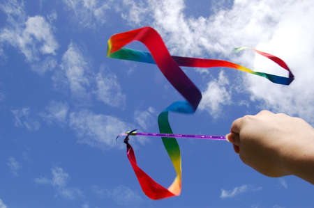 swinging the rainbow ribbon on the air Stock Photo