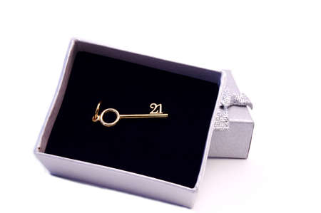 Gift box with a golden key for 21th birthday Stock Photo
