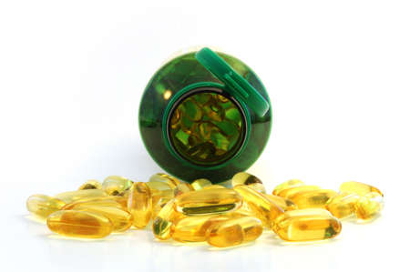 close up of fish oil + epo caplet . Looking straight into the container. Healthy supplement photo