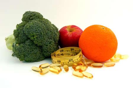Apple,orange, broccoli,fish oil caplets and measure tape