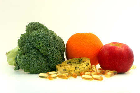 Healthy Life. Broccoli,orange,apple,fish oil,measure tape Stock Photo
