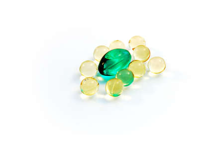 doctor fish wellness fish: Green caplet surrounded by small yellow caplets
