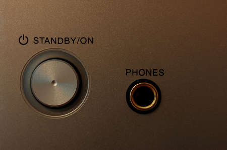 Power on button with headphoneearphone jack Stock Photo