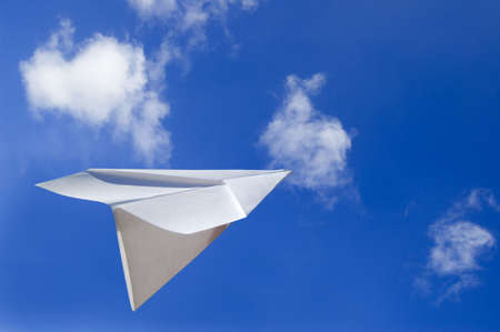 Paper Airplane Flying in the Air Stock Photo