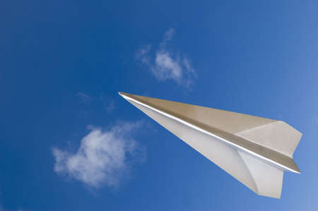 Paper airplane fly across the top - Contain the clipping path for the paperplane to let you select on the plane itself and cutcopy it to your design Stock Photo