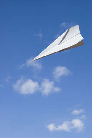 Paper airplane glide toward the ground and ready to land. - Contain the clipping path for the paperplane to let you select on the plane itself and cutcopy it to your design Stock Photo