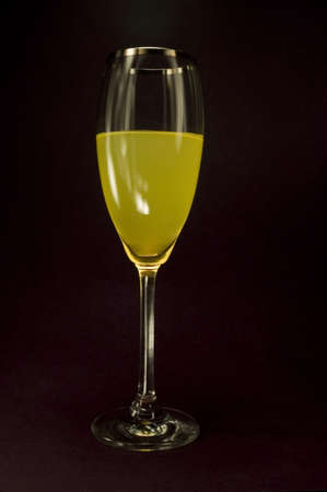 Isolated orange liquor in black color background