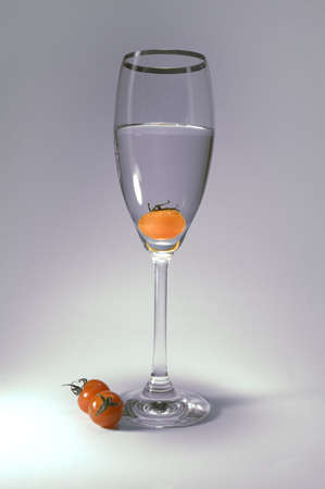 Tomato in the glass, soft lightning . clean perspective Stock Photo