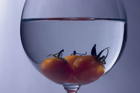 Close up view of tomato inside the wine glass Stock Photo