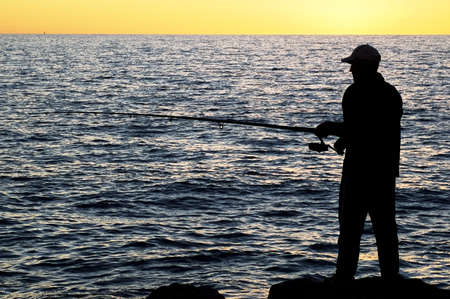Silhouette of Fisherman at sunset - Cottesloe beach , Perth