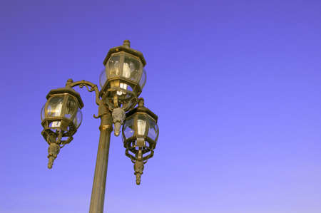 Lamp post under the blue sky photo