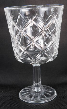 A beautiful vintage glass with relief to drink wine