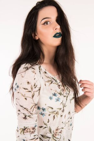 Photographing in the studio a model with blue lips and white background
