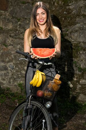 A model with fruit for healthy nutrition