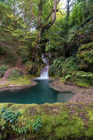 This beautiful waterfall is in the north of Spain inside a forest 写真素材