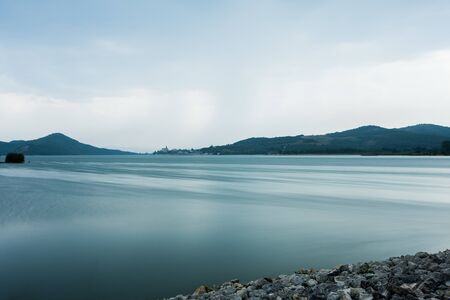 In this lake in northern Spain there is a small town in the background 写真素材