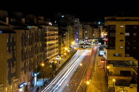 Long exposure of vehicles passing through an avenue of a Spanish city