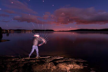 Self-portrait strobe fishing at dusk in a lake 版權商用圖片