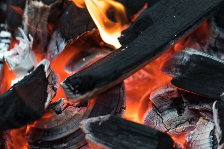 Charcoal embers burning with fire and ashes preparing for a spring and summer barbecue