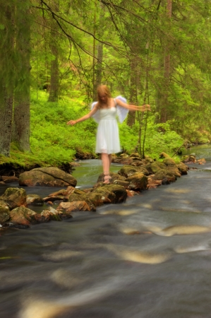 Angel walking on the rocks photo