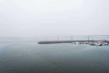 Harbour scene in a foggy day Stock Photo - 17067225