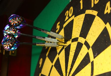 triple: Dart board and darts hitting triple 20 Stock Photo