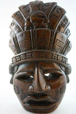upright: Mayan carved mask, upright  isolated on white Stock Photo