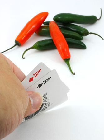 Poker player views pair of aces, red hot hand and bet Stock Photo - 6057333