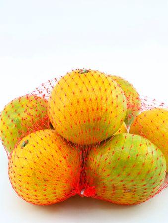 Japanese oranges bagged , fruit stacked on white background