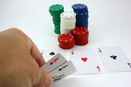 Poker player views pocket aces, four of a kind after flop
