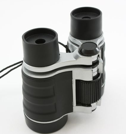 upright: Black modern optical binoculars, standing upright view