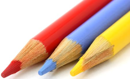 Pencil crayons, red, blue yellow primary colors angled photo