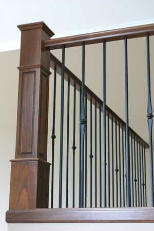 wooden railings: Bannister with wrought iron and beautiful stained oak