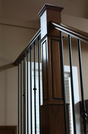 wrought: Corner bannister, wrought iron black and stained oak wood