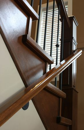 Custom designed staircase, wrought iron and stained oak photo