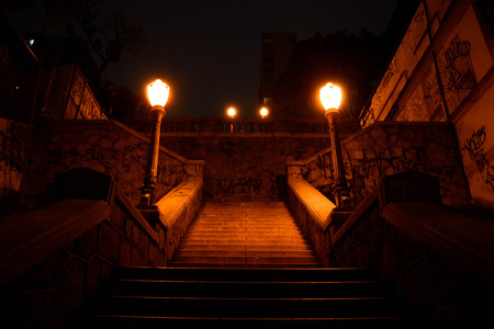 oldstyle: Iluminated old-style stair at city night Stock Photo