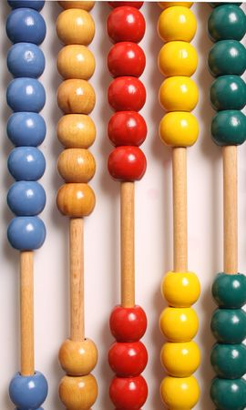 Wooden vertical abacus on a white background photo