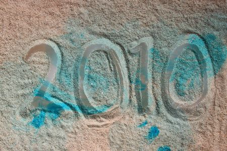 pecker: New year , letters written in sand with use of blue ink