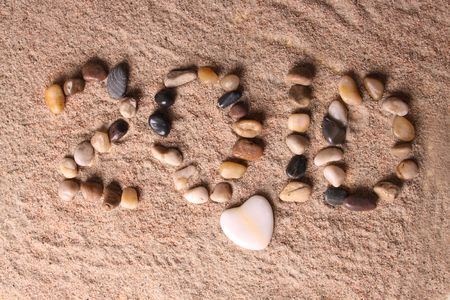 pecker: Composition of little stone in sand forming the numbers of this new year