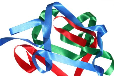 Satin ribbon in the colors red, green en blue, careless draped on withe isolated background Stock Photo - 5065445