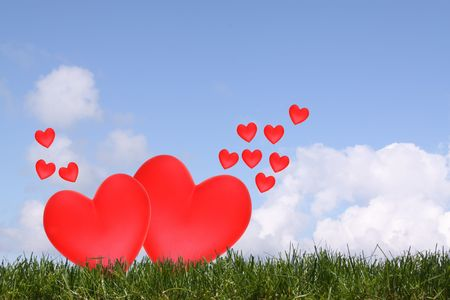 Red hearts in a free open sky photo