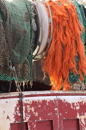 fishingboat: Colorful nets on a fishing-boat Stock Photo