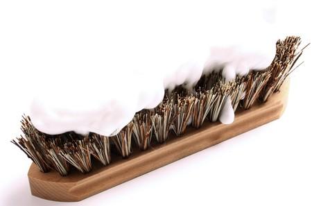 Brush overwhelmed by soap Stockfoto