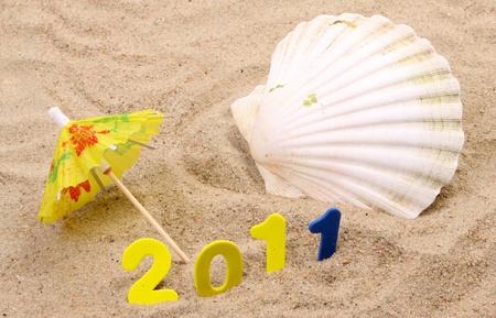mini umbrella: Little sandy beach in the studio in a new years scene