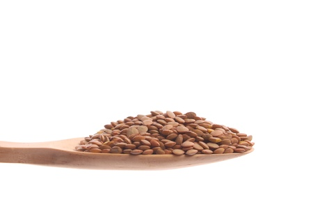 Lentils simply offered on a wooden spoon isolated on a white background  photo