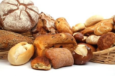 panadero: Varios tipos de pan fresco al horno, breadrolls y bollos Foto de archivo